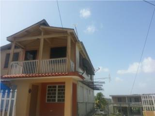 tres casas en una propiedad
