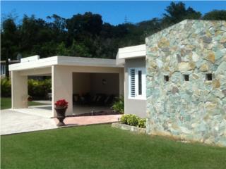 Casa con sistema de energia solar de 2kw