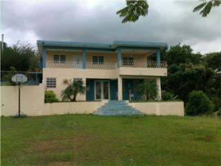 Casa con dos propiedades adicionales