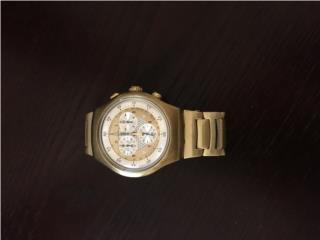 Reloj Swatch dorado unisex solo $60 omo, Puerto Rico