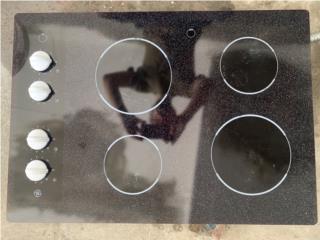 Tope de Estufa Eléctrica Negra GE 4 Hornillas, Puerto Rico
