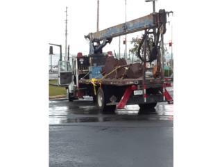 Boom truck con barreno y canasto, International Puerto Rico