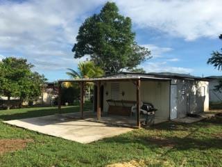 EXCELENTE Solar con casa de madera 55k