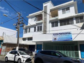 Edificio Calle Muñoz Rivera, locales y apts.