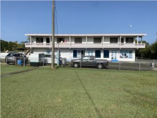 Edificio con uso mixto, comercial/residencial