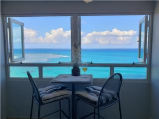 Breezy beachfront apartment with view of paradise Puerto Rico