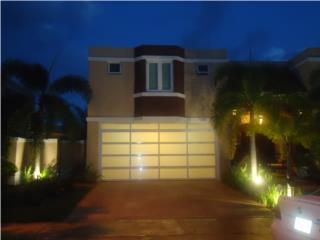 PUERTA GARAGE MODELO EN CRISTAL ELEGANTES, PUERTO RICO GARAGE DOORS INC. Puerto Rico